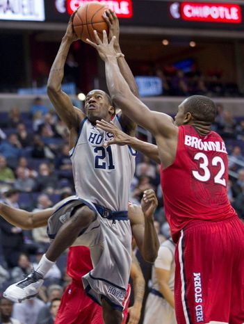 "ASSOCIATED PRESS Georgetown guard Jason Clark (21) acknowledges his team's tour of China will ""be a huge cultural change."""