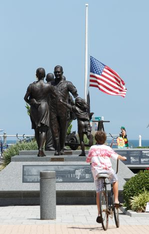 A U.S. flag flies at half-staff Monday at a Navy memorial in Virginia Beach, home of SEAL Team 6. Twenty-two SEALs, 20 of them from Team 6, were among 30 elite forces killed in Afghanistan Saturday. (Associated Press)