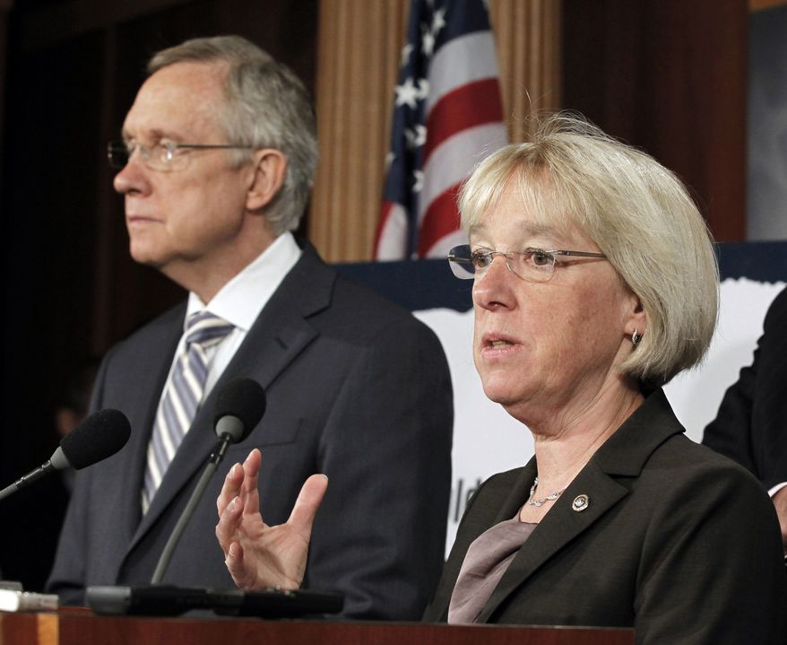 """** FILE ** In this July 27, 2011, file photo, Sen. Patty Murray, Washington Democrat, speaks as Senate Majority Leader Harry Reid listens at a news conference on Capitol Hill in Washington. Reid announced Tuesday, Aug. 9, 2011, he's naming Murray to co-chair a powerful """"super committee"""" charged with finding more than $1 trillion in deficit cuts this fall. (AP Photo/J. Scott Applewhite)"""