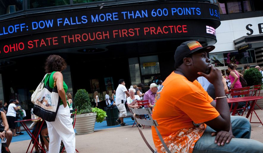 News of a massive stock selloff rolls around a ticker in Times Square, Monday, Aug. 8, 2011, in New York. The Dow Jones industrials closed down 634 points, or 5.5 percent, to 10,809. It was the first time the Dow fell below 11,000 since November and its biggest one-day point drop since December 2008. (AP Photo/John Minchillo)