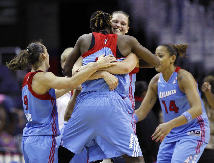 The Atlanta Dream celebrate their last-second 72-70 win over the Washington Mystics. (AP Photo/Manuel Balce Ceneta)