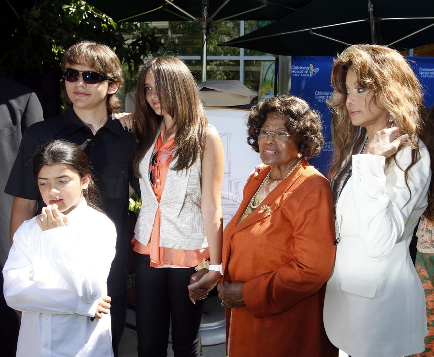 Members of the Jackson family, left to right, Blanket Jackson, Prince Jackson, Paris Jackson, Katherine Jackson and La Toya Jackson pose Monday Aug. 8, 2011, at Children's Hospital in Los Angeles after a presentation of 13 pieces of original artwork by pop icon Michael Jackson were donated to the hospital. (AP Photo/Nick Ut)
