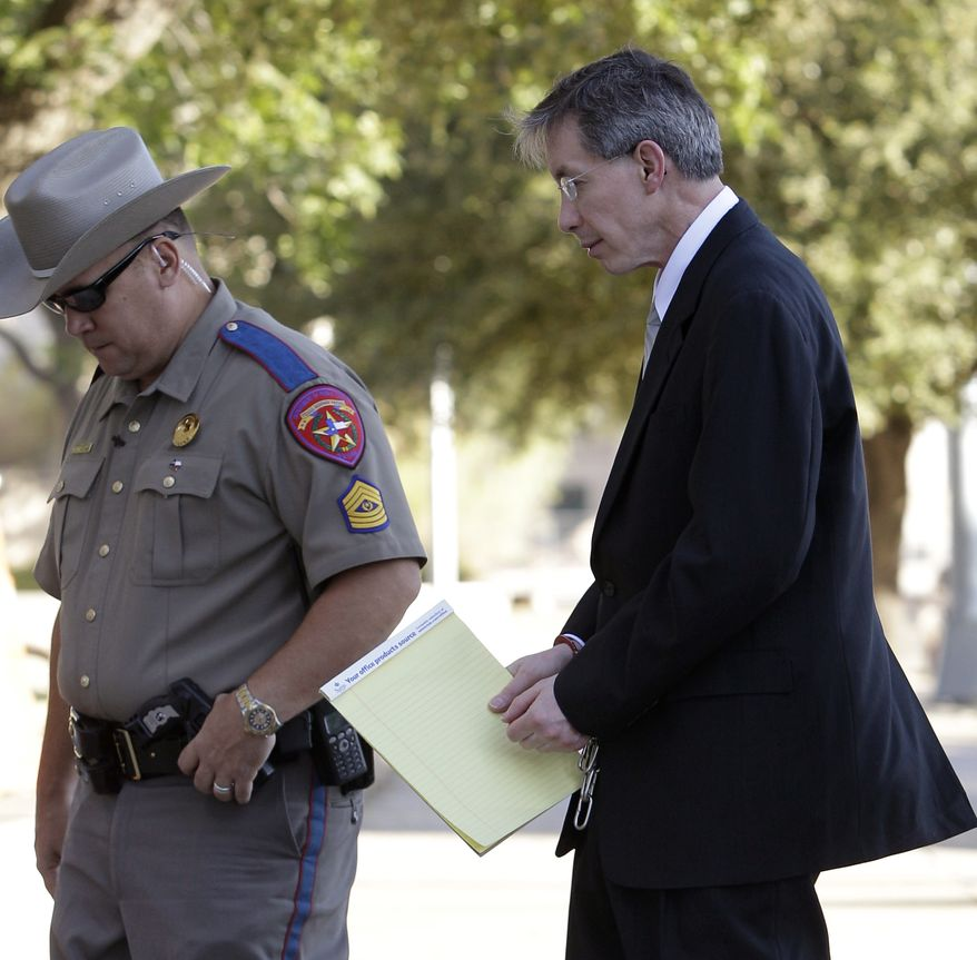 ** FILE ** Polygamist religious leader Warren Jeffs arrives in hand shackles to the Tom Green County Courthouse for the sentencing phase of his trial Friday, Aug. 5, 2011, in San Angelo, Texas. (AP Photo/Tony Gutierrez)