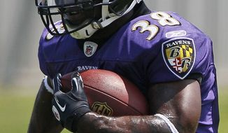 Baltimore Ravens running back Ricky Williams is expected to serve as backup to Ray Rice. He passed his physical and practiced with the Ravens for the first time Tuesday. (AP Photo/Patrick Semansky)