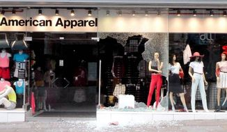 American Apparel shows signs of damage on Market street in Manchester city centre, England,  Tuesday Aug. 9, 2011.     (AP Photo /  Dave Thompson / PA)