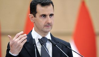 **FILE** Syrian President Bashar Assad (Associated Press/SANA)