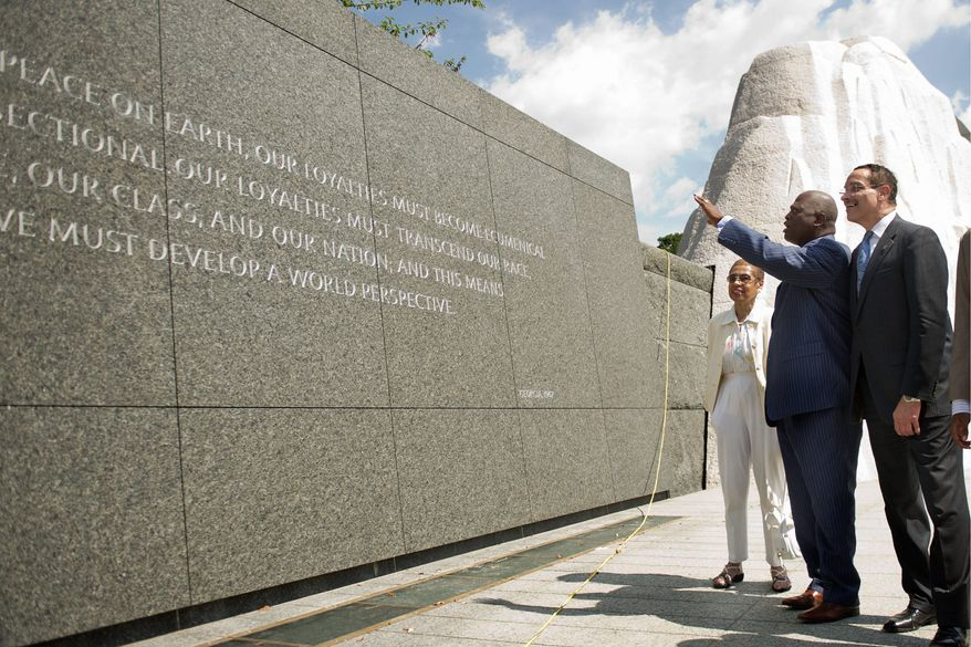 Harry E. Johnson (center), president and CEO of the Martin Luther King Jr. National Memorial Project Foundation, gives D.C. Mayor Vincent C. Gray and Delegate Eleanor Holmes Norton a tour of the memorial Wednesday in anticipation of its dedication at the end of August. (Drew Angerer/The Washington Times)