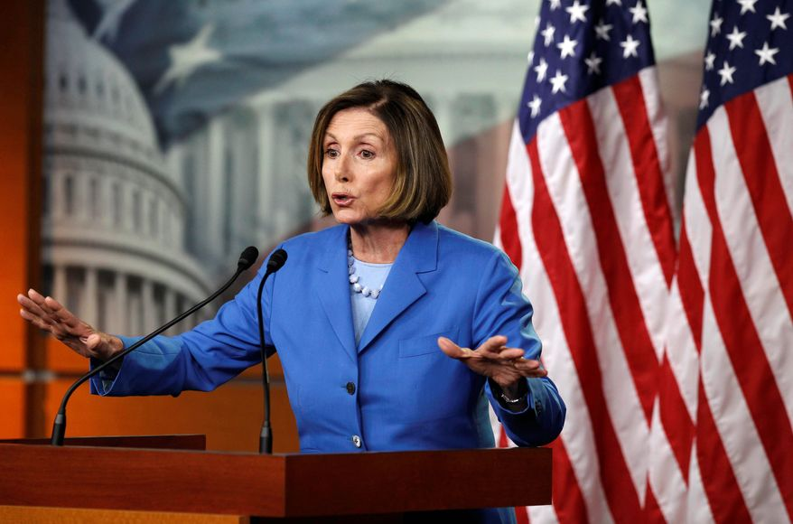 House Minority Leader Nancy Pelosi of Calif. gestures while speaking on Capitol Hill Friday, July 8, 2011, in Washington, to discuss the debt ceiling. (AP Photo/Alex Brandon)