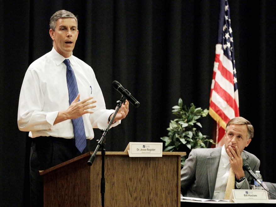 Education Secretary Arne Duncan (left) and Tennessee Gov. Bill Haslam, a Republican, take part in an education forum on Wednesday in Nashville, Tenn. Mr. Duncan plans to reward states, among them Tennessee, with waivers from the No Child Left Behind education law. (Associated Press)