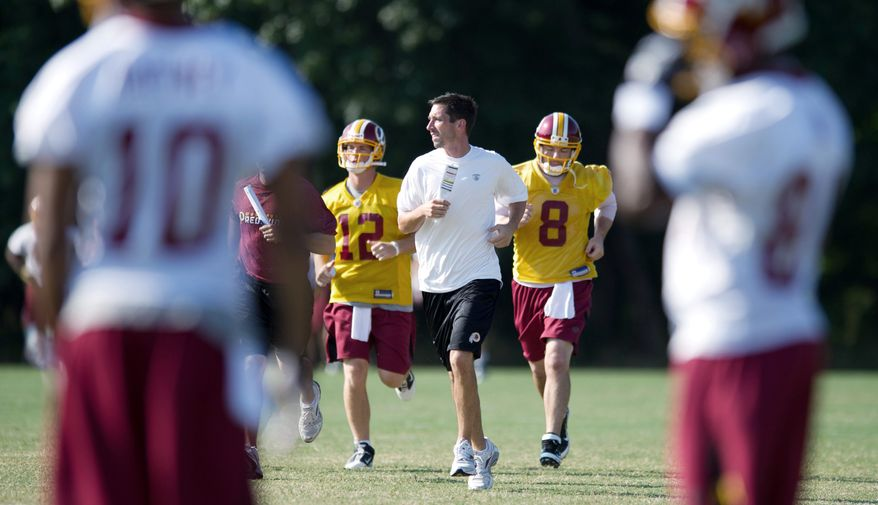 Offense coordinator Kyle Shanahan (center) said the best way to gauge his quarterbacks is to see them against other teams. The Redskins open the preseason Friday against the Steelers. (Rod Lamkey Jr./The Washington Times)