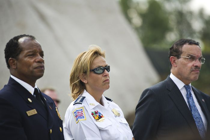 From left, D.C. Fire Chief Kenneth Ellerbe, D.C. Police Chief Cathy Lanier and Mayor Vincent are seen during a press conference at the site of the new Martin Luther King Jr. National Memorial. (Drew Angerer/The Washington Times)