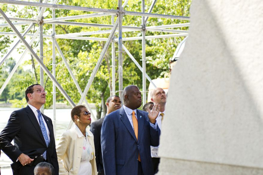 At right in the blue suit, President/CEO of the Martin Luther King, Jr. National Memorial Project Foundation Harry E. Johnson gives D.C. Mayor Vincent Gray and Del. Eleanor Holmes Norton a tour at the site of the new Martin Luther King Jr. National Memorial. (Drew Angerer/The Washington Times)