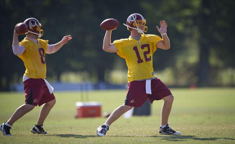 Washington Redskins quarterbacks Rex Grossman (left) and John Beck take part in passing drills during training camp. (Rod Lamkey Jr./The Washington Times)