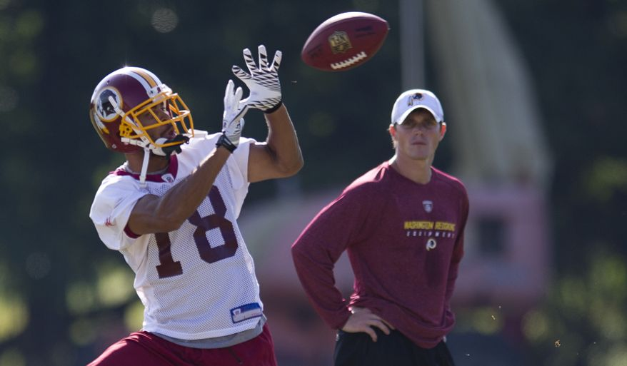 Washington Redskins wide receiver Terrence Austin catches a pass during training camp on Wednesday. (Rod Lamkey Jr./The Washington Times)