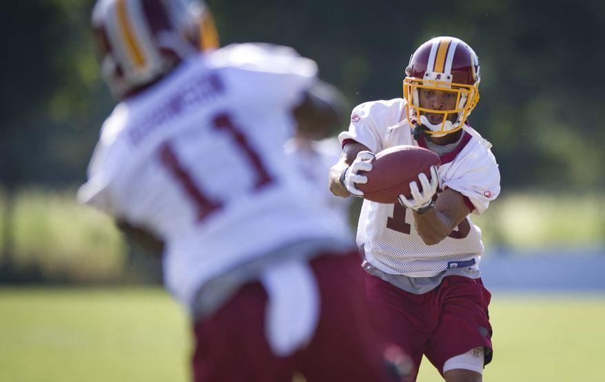 Washington Redskins  wide receivers Leonard Hankerson, right, and Aldrick Robinson run through drills at training camp Wednesday. (Rod Lamkey Jr./The Washington Times)