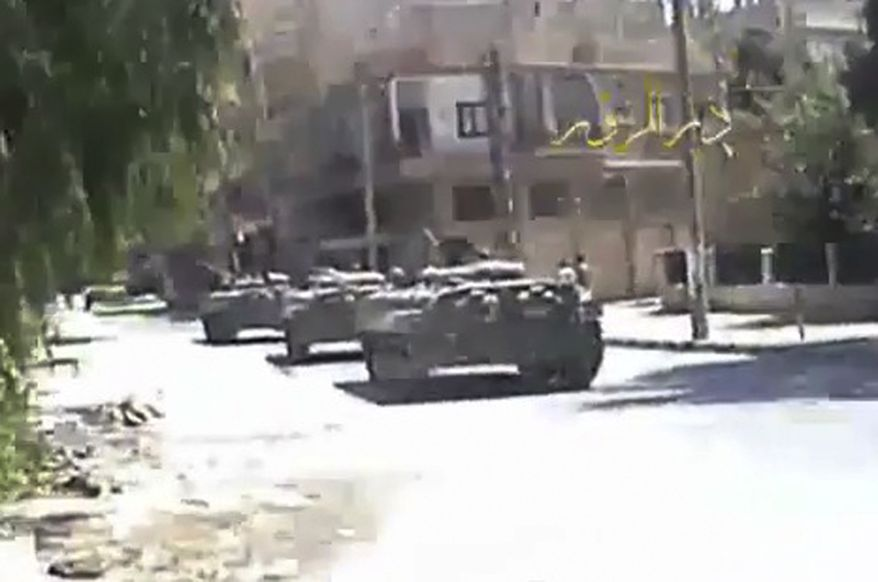 An image made from amateur video released by Deir el-Zour Press News (DPN) and accessed via Associated Press Television News on Wednesday, Aug. 10, 2011, shows Syrian tanks on the streets of Deir el-Zour, Syria, on Tuesday, Aug. 9. 2011. Government troops seized control of the eastern flashpoint city  Wednesday following intense shelling and gunfire, an activist said. (AP Photo/DPN via APTN)