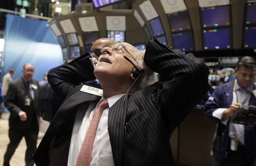 Trader Peter Tuchman works on the floor of the New York Stock Exchange on Aug. 10, 2011. (Associated Press)