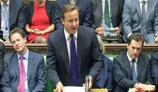British Prime Minister David Cameron (center), Deputy Prime Minister Nick Clegg (left) and Chancellor of the Exchequer George Osborne (right) are pictured in Britain's House of Commons in August 2011. (Associated Press)