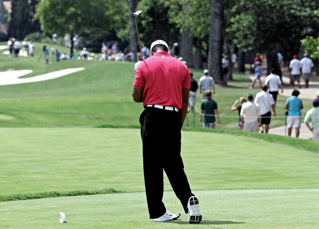 Tiger Woods' woes continued when he carded three double bogeys and five bogeys to fall 14 shots off the pace at the PGA Championship at Atlanta Athletic Club on Thursday. (AP Photo/David J. Phillip)