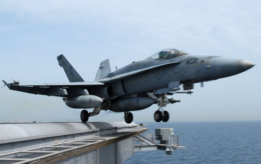 ** FILE ** An F/A-18C Hornet takes off from the Nimitz-class aircraft carrier USS John C. Stennis (CVN 74) in March 2007. (AP Photo/U.S. Navy, Paul J. Perkins, File)