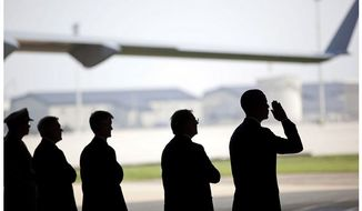 White House image of President Obama during the dignified transfer of remains of troops killed in Afghanistan, Dover AFB, August 9, 2011.