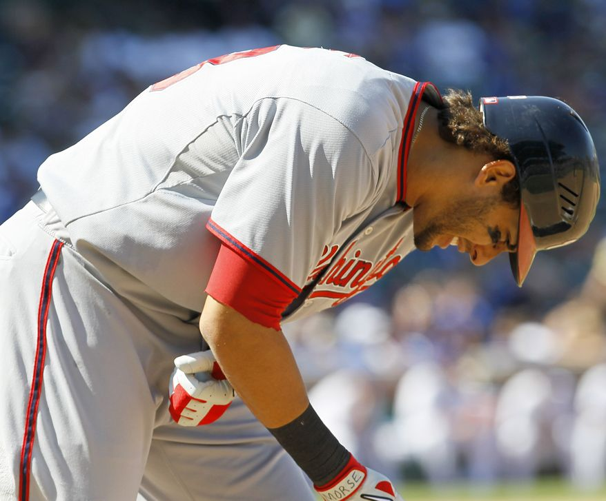 Washington Nationals' Michael Morse reacts after being hit by a pitch from Chicago Cubs starter Ryan Dempster during the seventh inning of a Thursday. Morse left the game and was taken for X-rays. (AP Photo/Charles Rex Arbogast)