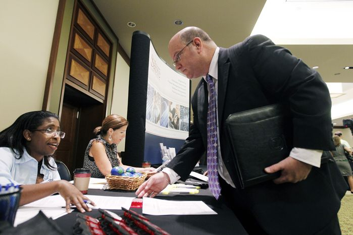Job seeker Ted Koblick speaks with recruiter Catrina Stagnato during a Career Job Fair in Arlington, Va., on Aug. 4, 2011. (Associated Press)