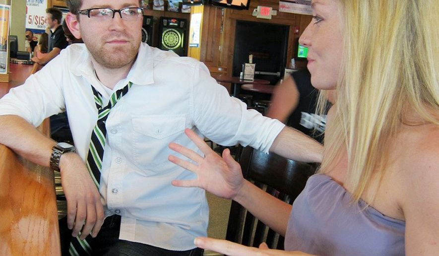 "Joshua Mitchell, founder of the wing-woman service Miss Pivot, gives new recruit Lacy Meyer tips at an Indianapolis bar. For $20 to $50 per hour, professional wing women facilitate conversation with women whom their male clients might not otherwise approach. ""There's so much to learn, and what I'm learning is really helping me in my personal relationships,"" Ms. Meyer said. (Photo courtesy of Miss Pivot)"
