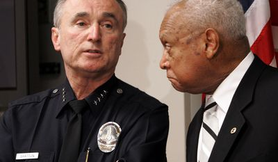 ** FILE ** In this Tuesday, Jan. 31, 2006, file photo, former Los Angeles Police Chief William Bratton, left, speaks as then Los Angeles Police Commission president John Mack listens following a commission hearing into the fatal shooting of a 13-year-old boy at Parker Center headquarters. (AP Photo/Nick Ut, File)