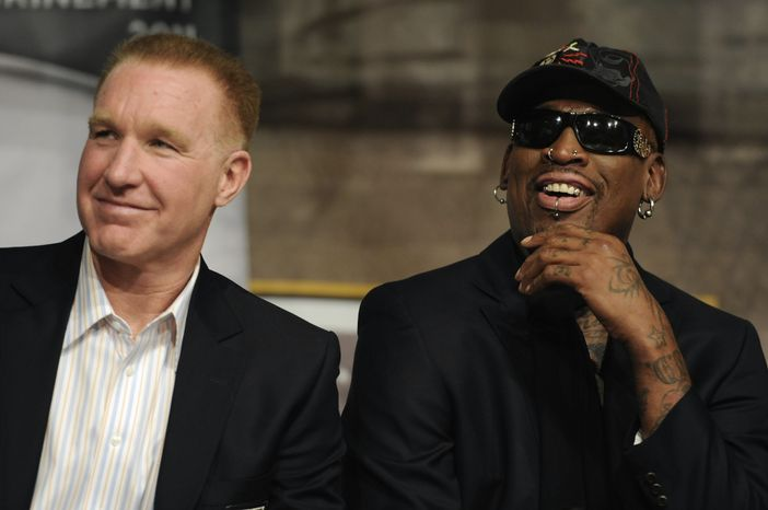 Chris Mullin and Dennis Rodman react during a news conference at the Naismith Memorial Basketball Hall of Fame in Springfield, Mass. on Thursday, Aug. 11, 2011. Mullin and Rodman will be inducted into the Basketball Hall of Fame on Friday. (AP Photo/Jessica Hill)