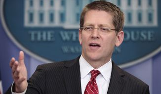 **FILE** White House Press Secretary Jay Carney gestures during his daily news briefing at the White House on Aug., 10, 2011. (Associated Press)