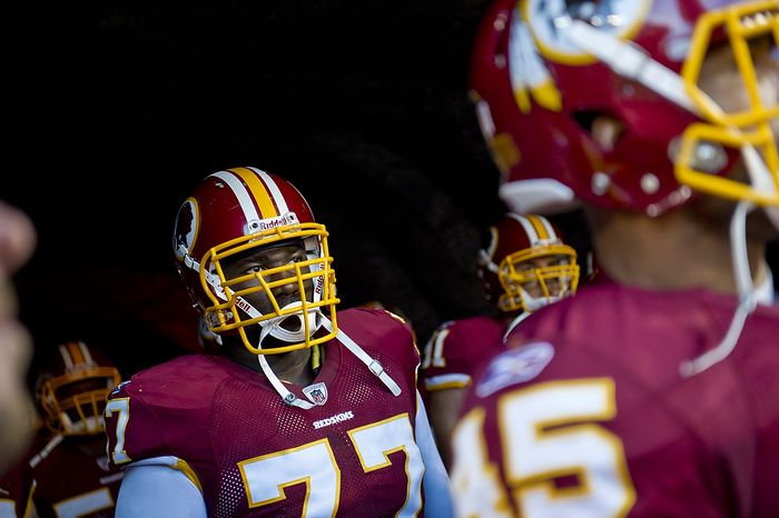 Washington Redskins tackle Jammal Brown (77) waits with his team to play the Pittsburg Steelers at FedEx Field in Landover, Md, Friday, August 12, 2011. (Rod Lamkey Jr./The Washington Times)