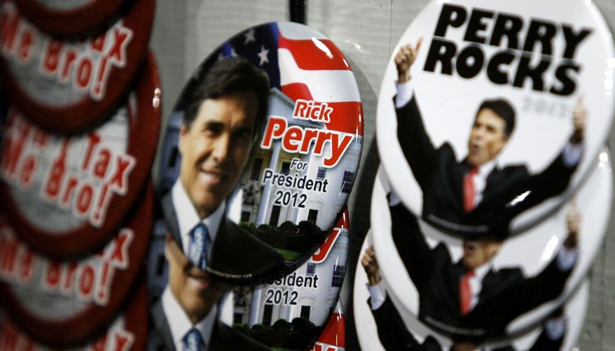 Rick Perry for President buttons are already appearing at the Republicans summer dinner where the Texas governor is speaking tonight in Birmingham, Ala. on Aug. 12, 2011. The Texas governor is expected to enter the race for 2012 GOP presidential nomination on Saturday with appearances in South Carolina and New Hampshire. (AP Photo/Butch Dill)