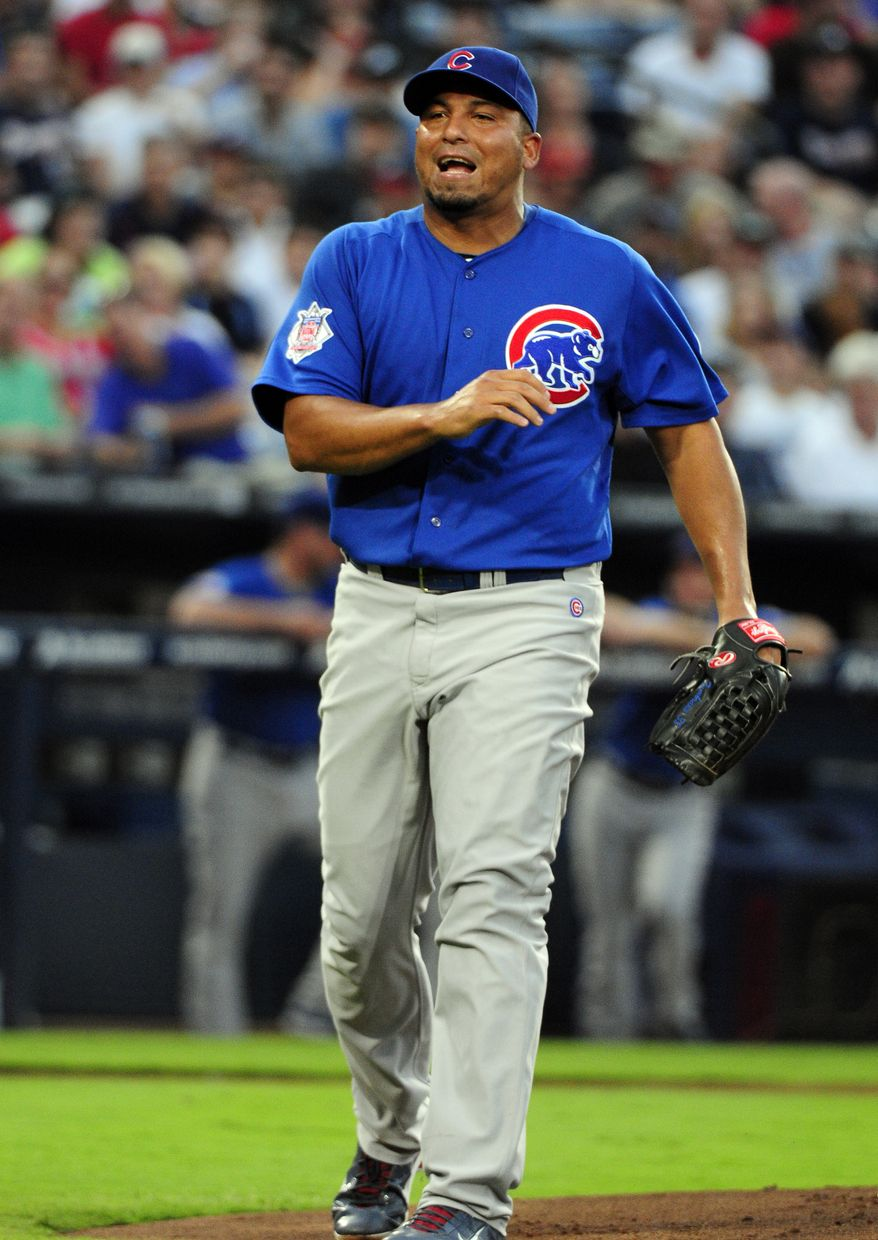 "Chicago Cubs starting pitcher Carlos Zambrano allowed a career-worst five homers against the Atlanta Braves on Friday, and manager Mike Quade said he then left the team. Quade said, ""His locker is empty. He walked out on 24 guys ... I don't know where he's gone or what he's doing."" Saturday, the Cubs placed him on the disqualified list. (AP Photo/Dave Tulis)"