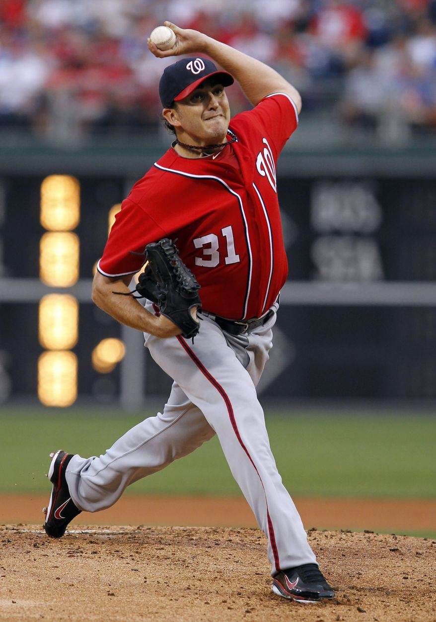 Washington Nationals starting pitcher John Lannan lasted three innings and gave up seven runs (one earned) in the Nats' 11-3 loss to the Philadelphia Phillies on Saturday. (AP Photo/Alex Brandon)