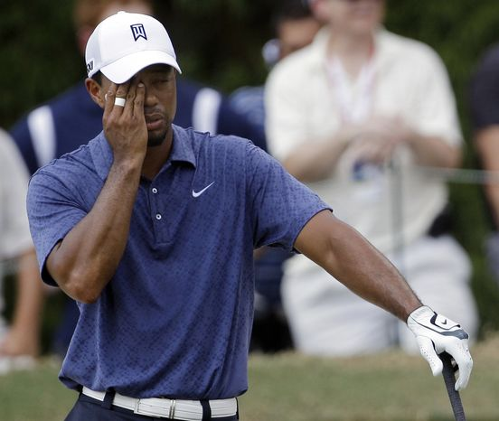 Tiger Woods reacts after hitting out of a bunker on the fifth hole during the second round of the PGA Championship golf tournament Friday, Aug. 12, 2011, at the Atlanta Athletic Club in Johns Creek, Ga. Woods bogeyed the par 5. (AP Photo/David J. Phillip)