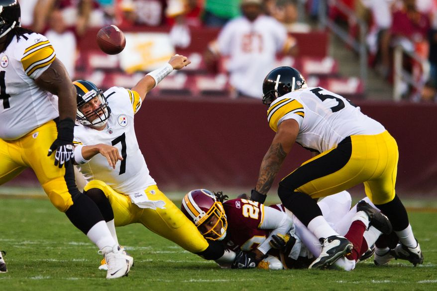 Redskins cornerback Kevin Barnes (22) takes down Steelers quarterback Ben Roethlisberger (7) in the backfield, during the first quarter of a preseason game between the Washington Redskins and the Pittsburgh Steelers, at FedEx Field in Landover, Md., Friday, Aug. 12, 2011. (Drew Angerer/The Washington Times)