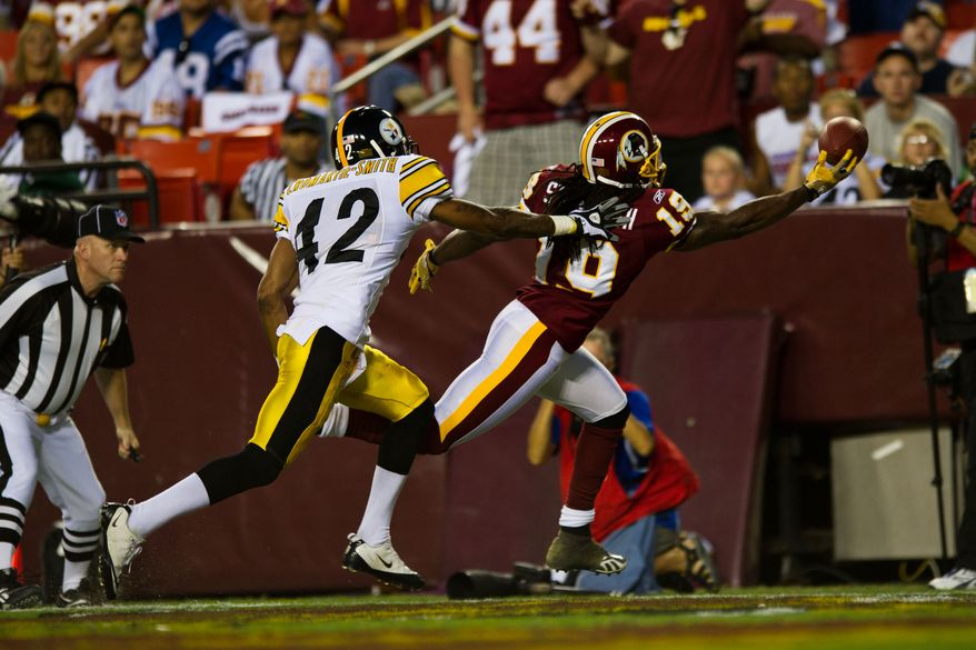 Redskins wide receiver Donte Stallworth (19) tries to haul in a pass while Steelers safety Da'Mon Cromartie-Smith (42) defends him, during the first half of a preseason game between the Washington Redskins and the Pittsburgh Steelers, at FedEx Field in Landover, Md., Friday, Aug. 12, 2011. (Drew Angerer/The Washington Times)