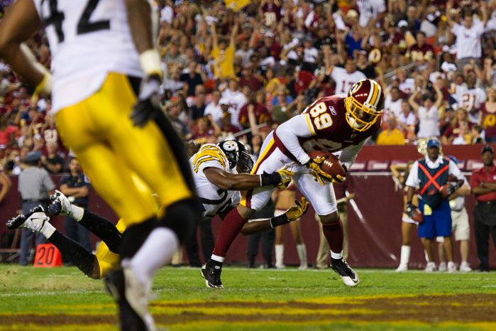 Redskins receiver Santana Moss (89) catches a pass and crosses the goal line in the first half to score the Redskins only touchdown, during a preseason game between the Washington Redskins and the Pittsburgh Steelers, at FedEx Field in Landover, Md., Friday, Aug. 12, 2011. (Drew Angerer/The Washington Times)