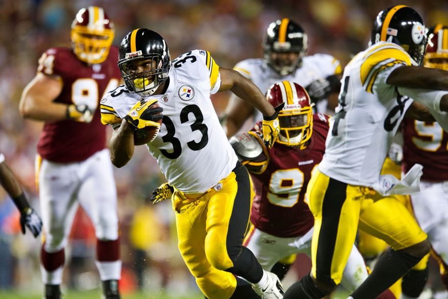 Steelers running back Isaac Redman (33) escapes Redskins defenders on his way to scoring the Steelers only touchdown of the game, during a preseason game between the Washington Redskins and the Pittsburgh Steelers, at FedEx Field in Landover, Md., Friday, Aug. 12, 2011. (Drew Angerer/The Washington Times)