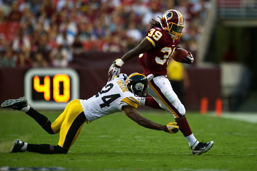 Redskins running back Tim Hightower (39) escapes a tackle from Steelers cornerback Ike Taylor (24) on a run in during the first half,  during a preseason game between the Washington Redskins and the Pittsburgh Steelers, at FedEx Field in Landover, Md., Friday, Aug. 12, 2011. (Drew Angerer/The Washington Times)