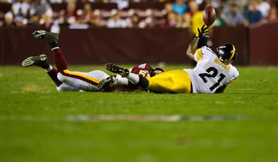 Steelers running back Mewelde Moore (21) tries to make a circus catch, during a preseason game between the Washington Redskins and the Pittsburgh Steelers, at FedEx Field in Landover, Md., Friday, Aug. 12, 2011. (Drew Angerer/The Washington Times)