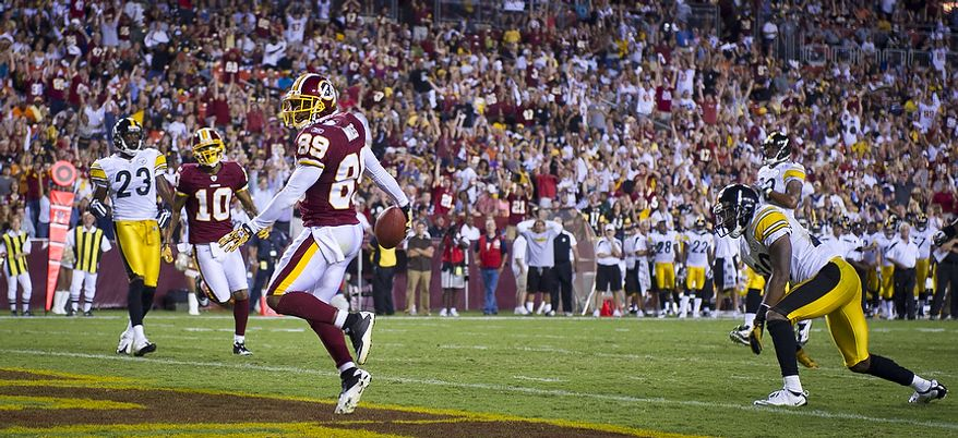 Santana Moss of the Washington Redskins (89) dances into the end zone as he scores a touchdown against the Pittsburg Steelers in the first quarter at FedEx Field in Landover, Md, Friday, August 12, 2011. (Rod Lamkey Jr./The Washington Times)