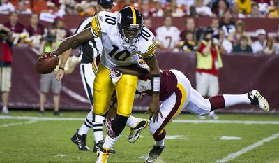 DeJon Gomes (24) of the Washington Redskins sacks Dennis Dixon (10) of the Pittsburgh Steelers at FedEx Field in Landover, Md., on Friday, Aug. 12, 2011. (Rod Lamkey Jr./The Washington Times)