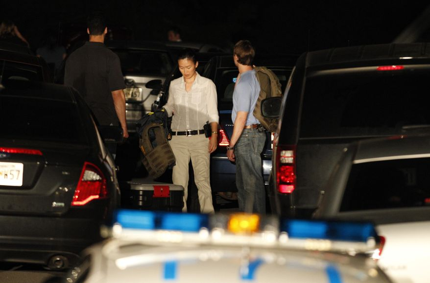 FBI agents are seen in the driveway of Gary Giordano house after a raid in Gaithersburg Md., on Friday, Aug. 12, 2011. Aruba has turned to the FBI for help investigating the disappearance of 35-year-old Robyn Gardner of Maryland, an agency spokesman said Thursday as official doubts grew about the story told by the suspect in the case. (AP Photo/Jose Luis Magana)