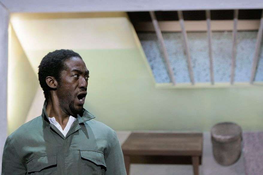 "ASSOCIATED PRESS PHOTOGRAPHS Aubrey Lodewyk performs a scene as Nelson Mandela in his prison cell. Mr. Mandela was imprisoned for 27 years for his anti-apartheid activities in South Africa. His life story is told in ""Mandela Trilogy."""