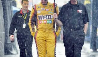 ASSOCIATED PRESS Pole-sitter Kyle Busch leaves the track at Watkins Glen International before Sunday's Sprint Cup race was postponed.