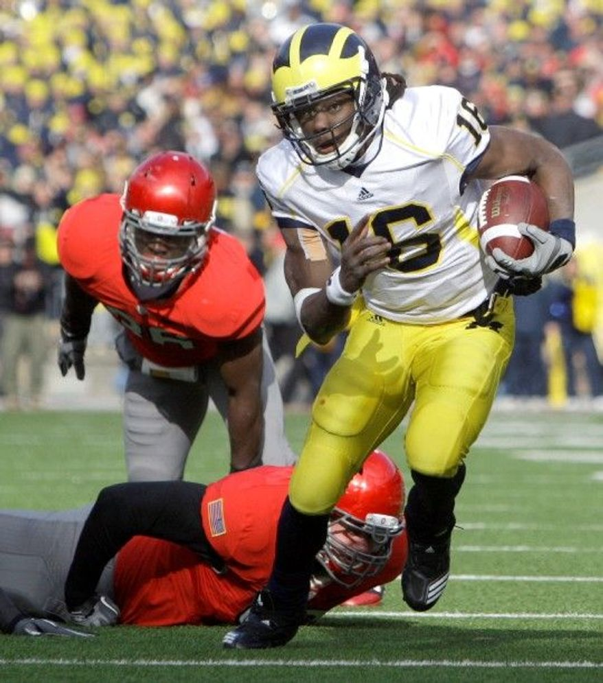 ASSOCIATED PRESS Last year, Michigan quarterback Denard Robinson became the first NCAA player with 1,500 yards rushing and passing in a season.