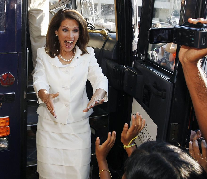 Rep. Michele Bachmann, Minnesota Republican, greets a group of supporters as she emerges from her campaign bus after winning the Iowa Republican Party's Straw Poll in Ames, Iowa, on Saturday, Aug. 13, 2011. (AP Photo/Charles Dharapak)