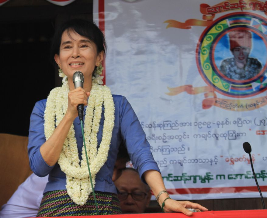 Myanmar democracy icon Aung San Suu Kyi speaks during the opening ceremony of the Aungsan Jar-mon Library on Sunday, Aug. 14, 2011, in Thanatpin, Myanmar. (AP Photo/Khin Maung Win)